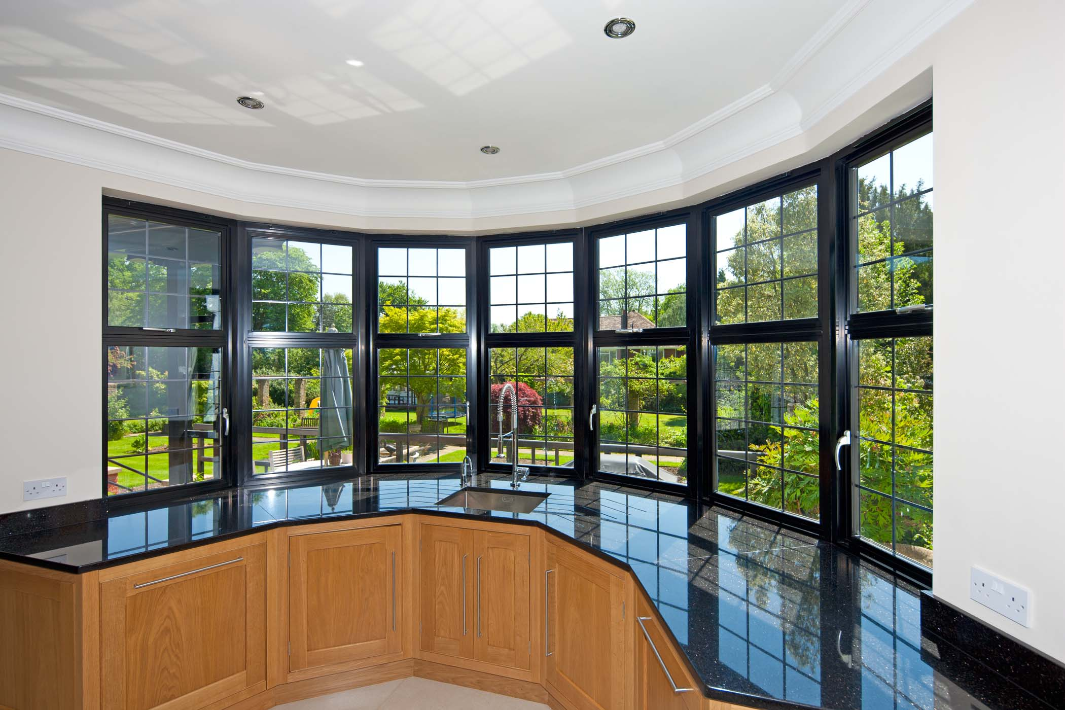 Curved aluminium Crown Casement windows on a residential project from Sapa
